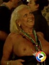 Old lady flashes her big tits to the crowd for beads at Mardi Gras